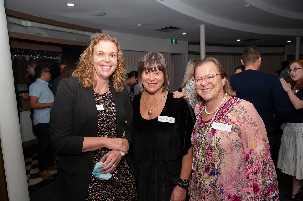Three women smiling together
